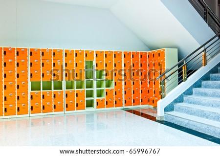 arrow sign on orange lockers - stock photo