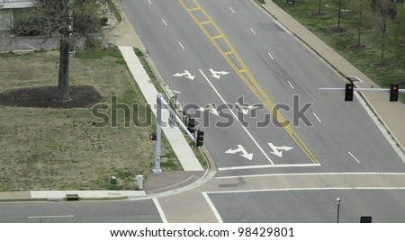Arrow signs at intersection of city streets - stock photo
