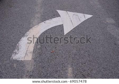 Arrow turn left on street - stock photo