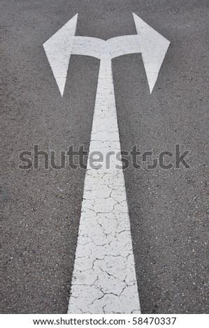 Arrow turn left or right on street - stock photo