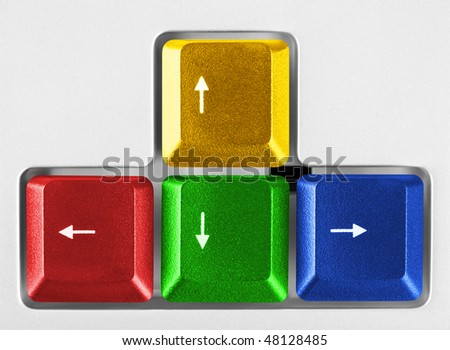 Arrows buttons on computer keyboard - technology background - stock photo