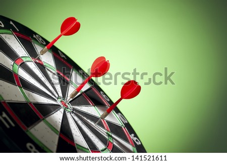 arrows darts hit the target and are shown on a green background