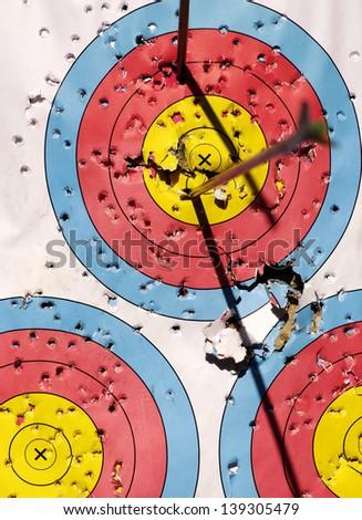 arrows focus to archery target - stock photo