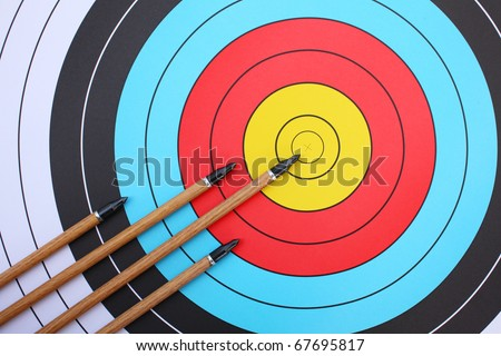 arrows focus to archery target. - stock photo
