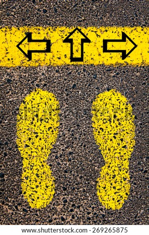 Arrows left, right, forward. Indecision Conceptual image with yellow paint footsteps on the road in front of horizontal line over asphalt stone background.  - stock photo