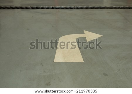 Arrows on asphalt road showing turn right - stock photo
