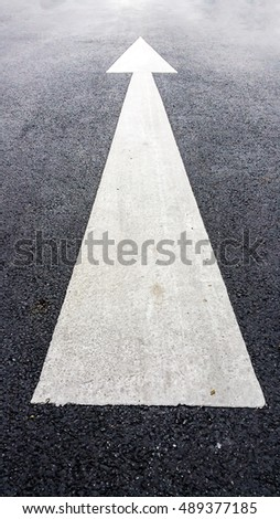 Arrows on asphalt road surface. Forward signs on the road
