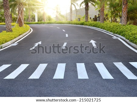 Arrows on asphalt road traffic regulations, safety - stock photo