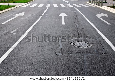 Arrows on the new urban road - stock photo