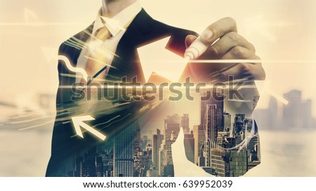 Arrows with double exposure of businessman and big city