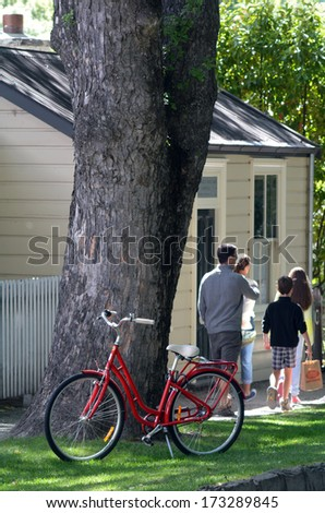 ARROWTOWN,NZ - JAN 17:Visitors in Arrowtown on Jan 17 2014.It's a popular travel destination with well preserved buildings dating from the gold mining days of the town. - stock photo