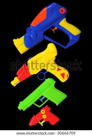 arsenal of summer water pistols - stock photo