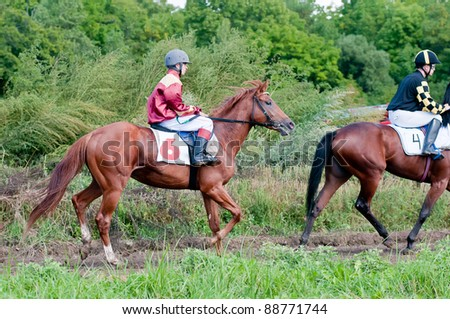 "ARSENEV, RUSSIA - SEPTEMBER 03:  Unidentified riders false start race horses on Riding show ""The Cup of the Governor of the Primorsky Territory, 2011"" on Sept 03, 2011 in Arsenev, Russia"