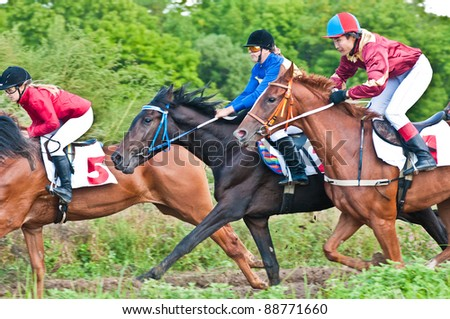 "ARSENEV, RUSSIA - SEPTEMBER 03:  Unidentified riders race horses on Riding show ""The Cup of the Governor of the Primorsky Territory, 2011"" on Sept 03, 2011 in Arsenev, Russia"
