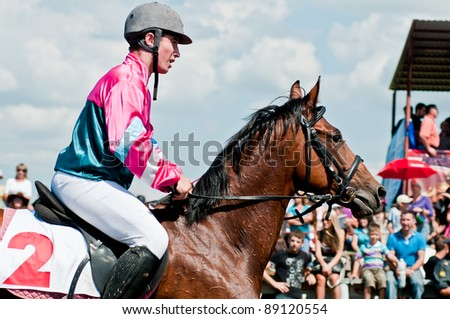 """ARSENEV, RUSSIA - SEPTEMBER 03:  Unidentified riders race horses on Riding show """"The Cup of the Governor of the Primorsky Territory, 2011"""" on Sept 03, 2011 in Arsenev, Russia - stock photo"""
