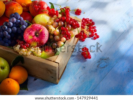 Art abstract market background fruits on a wooden background - stock photo