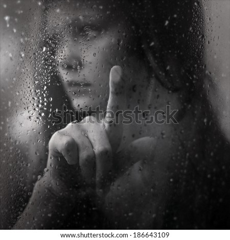 art black and white photo of girl and rain, portrait of a beautiful girl - stock photo