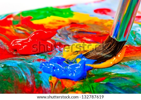 Art brush mixed paint on the palette - stock photo