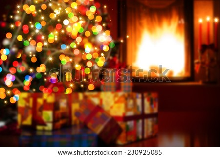 art Christmas scene with tree gifts and fire in background - stock photo