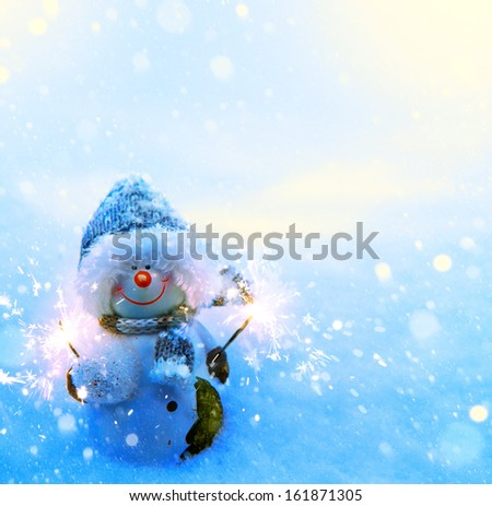 Art Christmas snowman and sparklers on blue snow background - stock photo