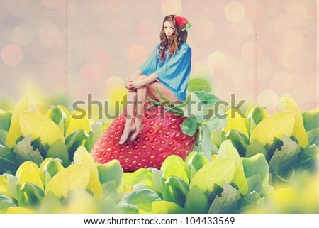 art collage with woman on strawberry