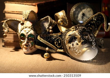 Art concept. Vintage still life with old books near masks