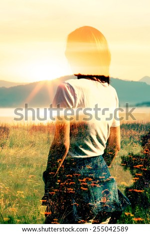 Art conceptual double exposure portrait of young woman in landscape, lake with manny yellow wild flowers in sunrise  - stock photo