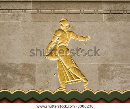 Art Deco frieze on a granite wall at Rockefeller Center in New York City. - stock photo