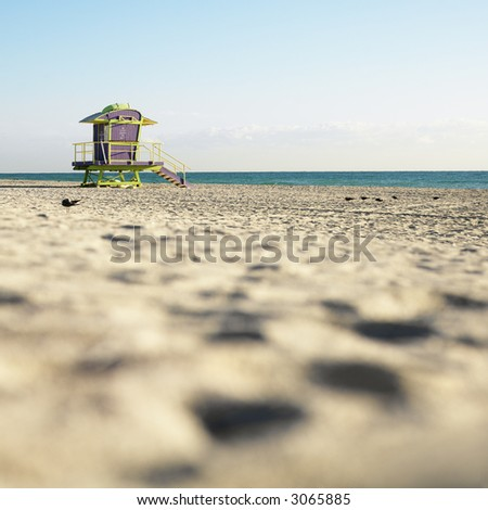 Art deco lifeguard tower on deserted beach in Miami, Florida, USA. - stock photo