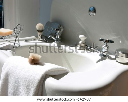 Art Deco pedestal sink and accoutrements for cleaning up. - stock photo