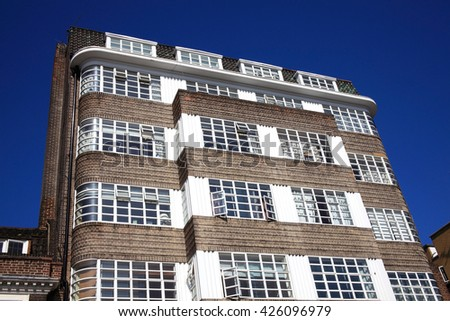 Art Deco residential apartment flats with a clear blue sky in Chelsea, London - stock photo