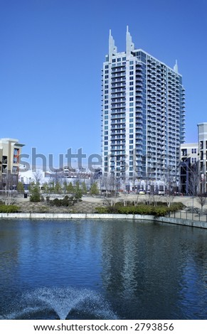 Art Deco style building in city of Atlanta with pond and fountain in foreground - stock photo