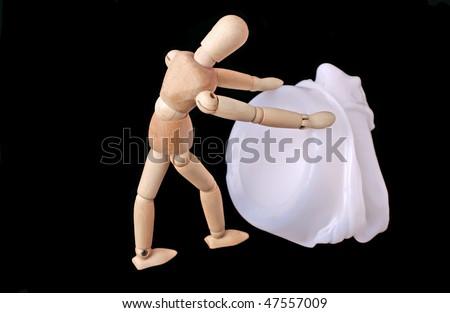 art doll pushing melted plastic bottle - stock photo
