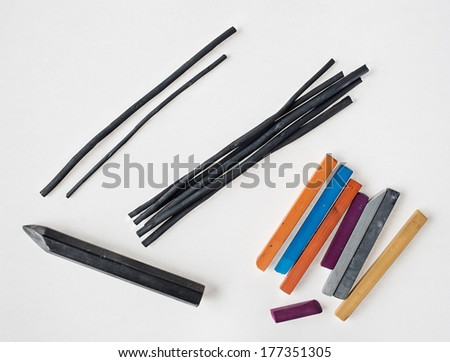 Art drawing tools: graphite pencil, crayons, charcoal, chalk pastels over white background. - stock photo