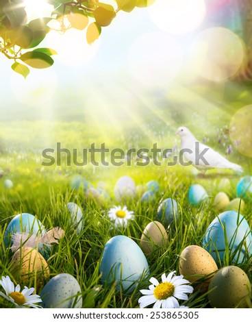 art easter eggs on spring field - stock photo
