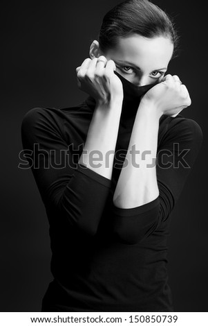 Art fashion photo of a beautiful woman over black background.