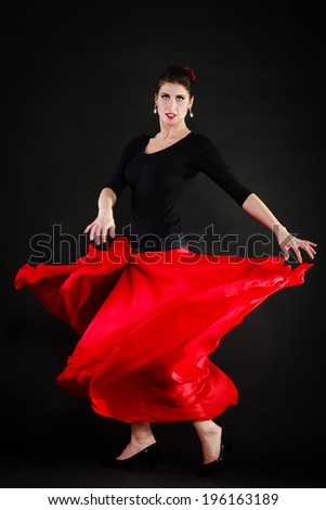 Art. Full length of sexy spanish girl attractive woman in red long skirt dancing flamenco traditional dance. - stock photo