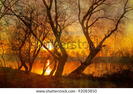 Art grunge landscape showing sunrise over the river on beautiful autumn day - stock photo