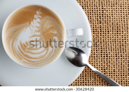 art latte on a cappuccino coffe cup - stock photo