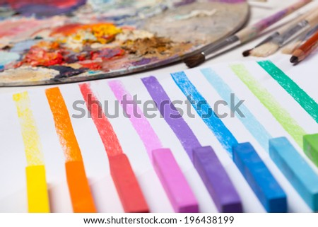 Art materials and colored lines painted in pastels - stock photo