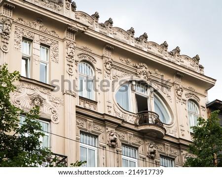 Art Nouveau building in Riga, round window balcony - stock photo