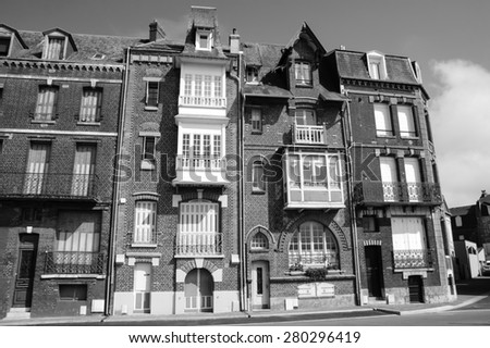 Art Nouveau style buildings in resort town Mers-les-Bains (Picardy, France). Aged photo. Black and white. - stock photo