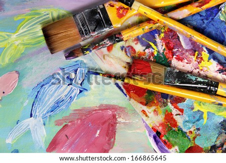 Art palette, picture and brushes with a lot of vivid colors        - stock photo
