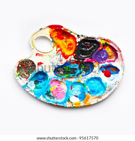 Art palette with blobs of paint - stock photo