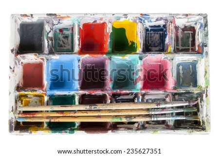 art palette with paint and brushes isolated on white