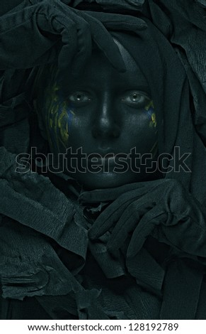 art photo of a beautiful woman with black face - stock photo