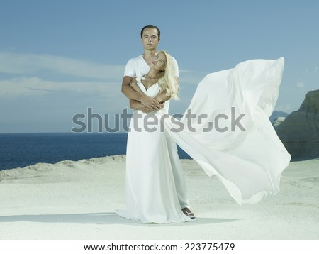 Art photo of bride and groom on the seashore. Fashion wedding - stock photo