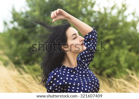 Art portrait of a beautiful brunette adult girl - stock photo