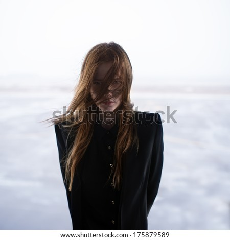 Art portrait of a beautiful girl in a black coat. photo Gothic - stock photo