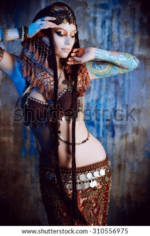 Art portrait of a beautiful traditional female dancer. Ethnic dance. Belly dancing. Tribal dancing. - stock photo